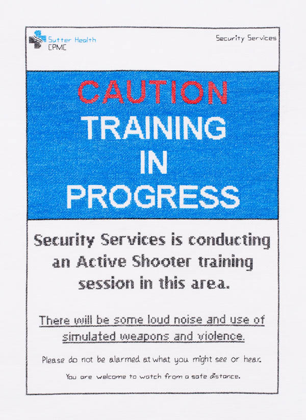 "Active Shooter Training Signage #1: cotton; 25.5""H X 20.5""W (framed); 2015; Photo: Miles Mattison"