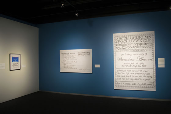 Active Shooter Training Signage #1 (left), Active Shooter Directions #1 (center) and  Sampler #10 (right) in Strategies for Survival Exhibit, Bellevue Arts Museum, Bellevue, WA, USA, 2016-2017; Photo courtesy of Bellevue Arts Museum.