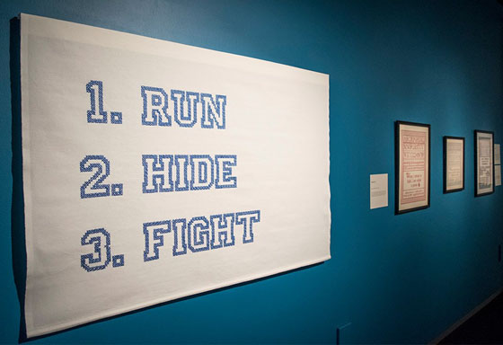 Active Shooter Directions #4 (left) and various samplers in Strategies for Survival Exhibit, Bellevue Arts Museum, Bellevue, WA, USA, 2016-2017; Photo courtesy of Bellevue Arts Museum.