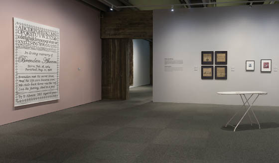 Sampler #10 (left) in Needle&#39s Eye Exhibit in Bergen, Norway, 2014; Photo: Dag Fosse. This work featured textiles from the collection of the museum alongside interpretations by contemporary artists. On the wall to the right of the doorway are some old samplers from their collection.